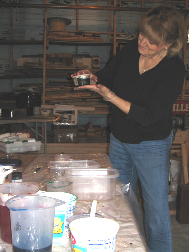 Marilyn Gilles squooshes a yard of silk into a teeny container