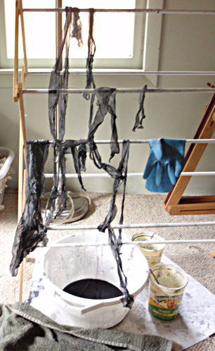 Dyed gray silk drying on a rack